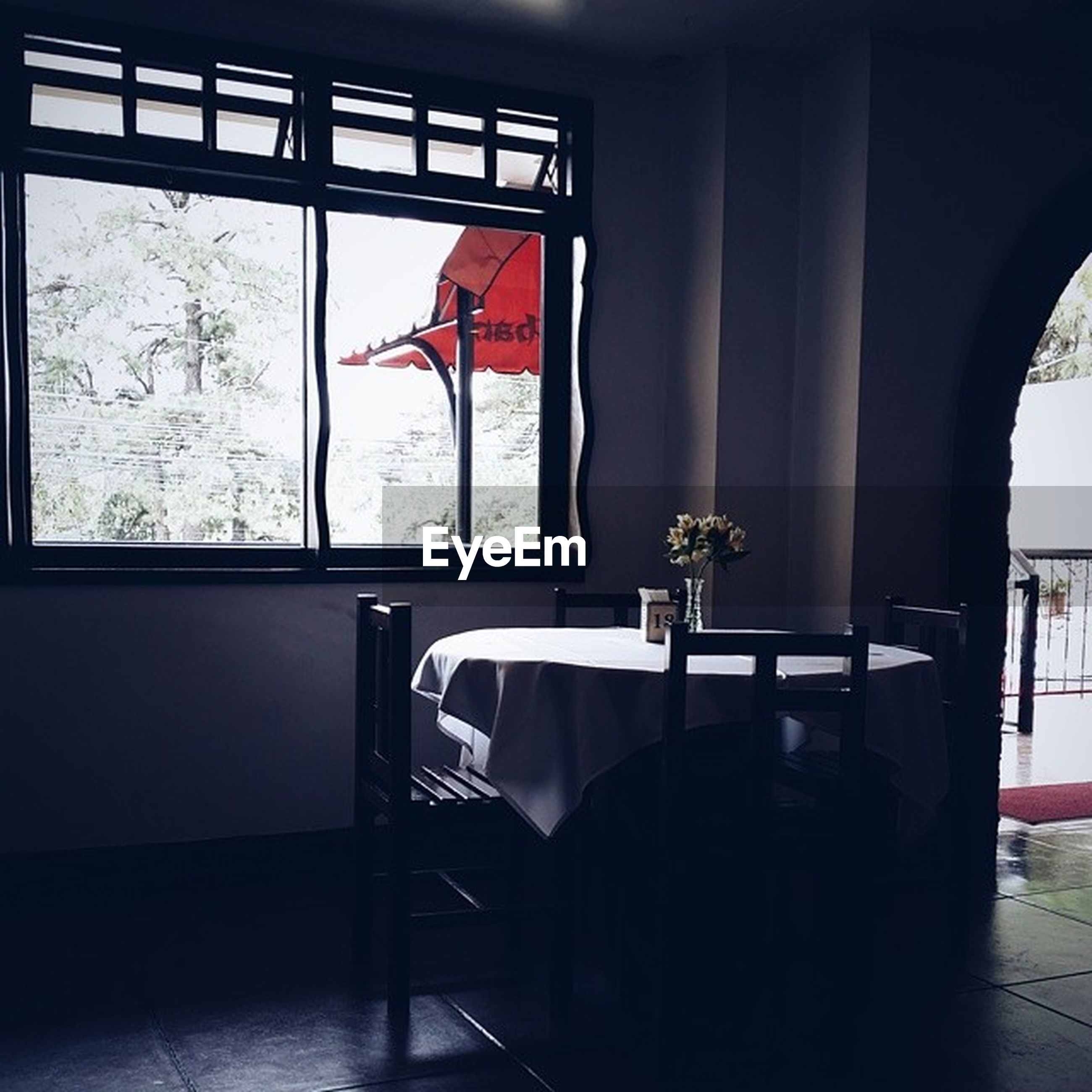 indoors, window, built structure, chair, architecture, glass - material, home interior, table, absence, day, hanging, curtain, transparent, red, sunlight, door, empty, sitting, house, restaurant
