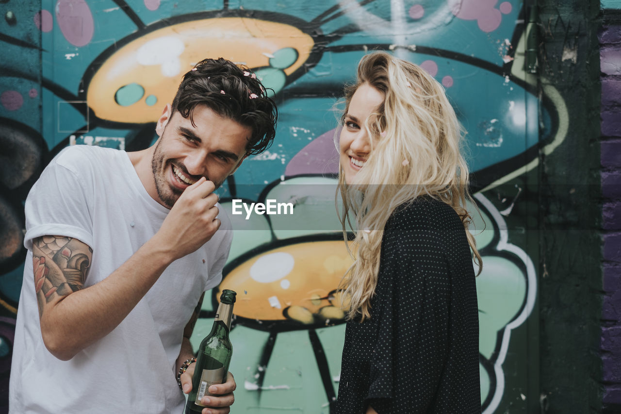 real people, young adult, young women, emotion, togetherness, lifestyles, smiling, women, adult, two people, happiness, leisure activity, love, men, casual clothing, waist up, bonding, young men, people, positive emotion, hair, couple - relationship, hairstyle