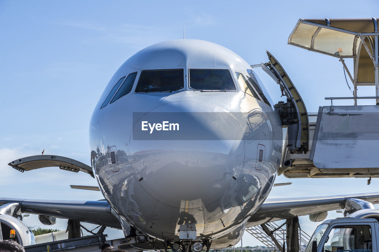 Close-up of airplane against clear blue sky
