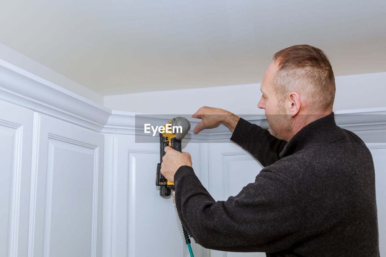 Man working on wall at home