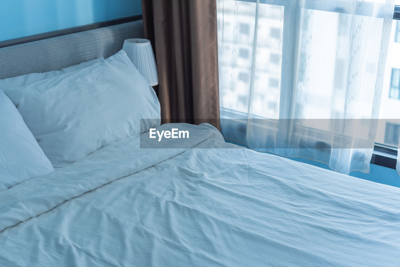 High angle view of bed in bedroom