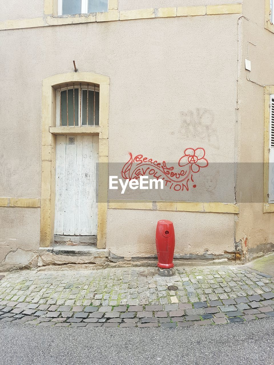 architecture, built structure, door, building exterior, graffiti, communication, day, outdoors, text, no people, red