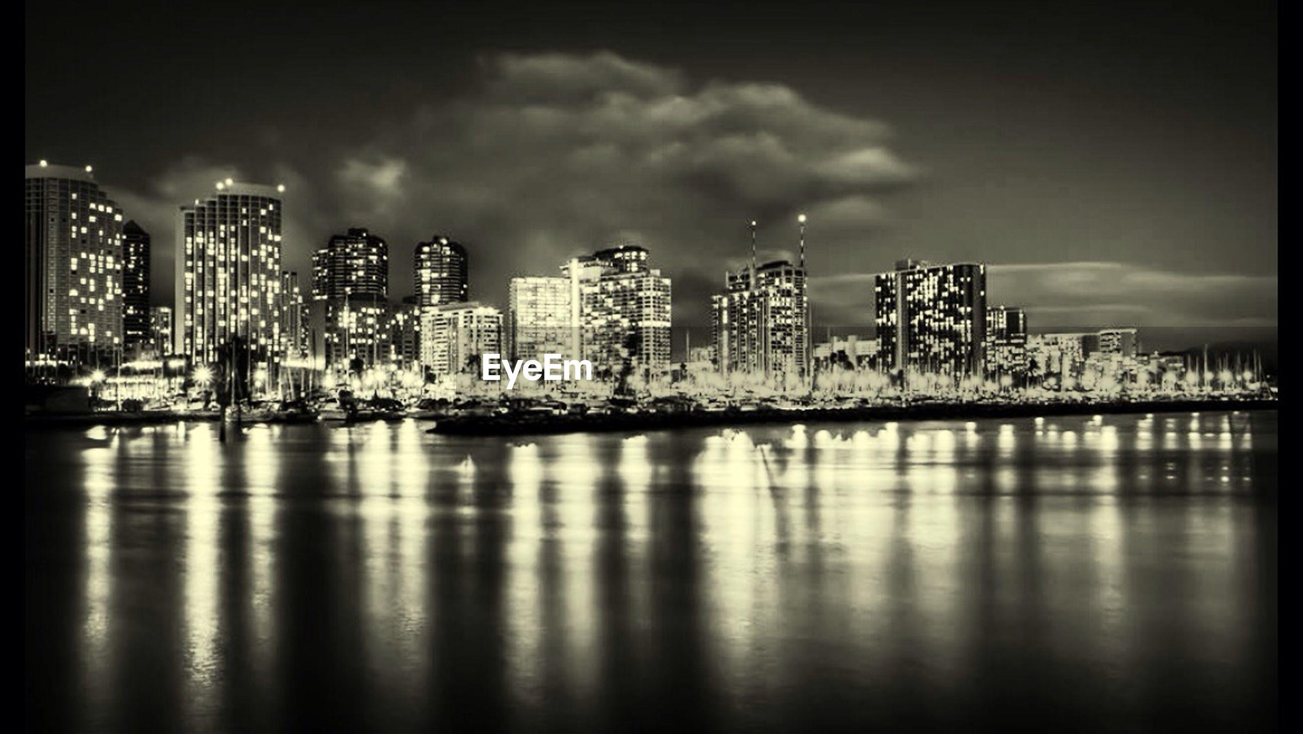 Illuminated cityscape and river