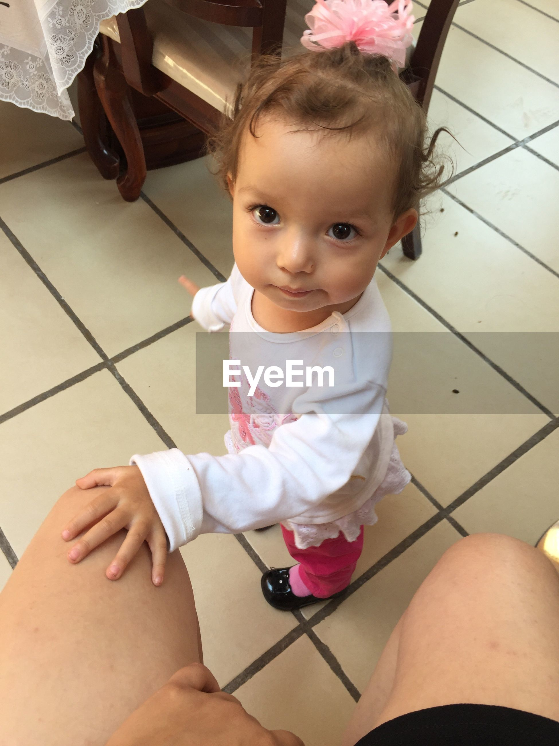 real people, childhood, one person, cute, baby, innocence, looking at camera, indoors, babyhood, high angle view, portrait, toddler, lifestyles, sitting, home interior, full length, day, close-up