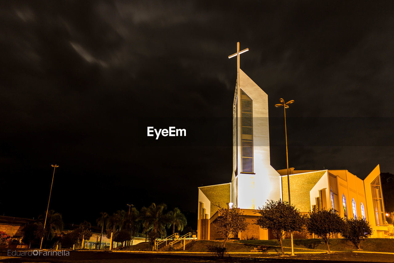 night, built structure, architecture, religion, spirituality, illuminated, building exterior, place of worship, sky, no people, low angle view, outdoors, tree, windmill
