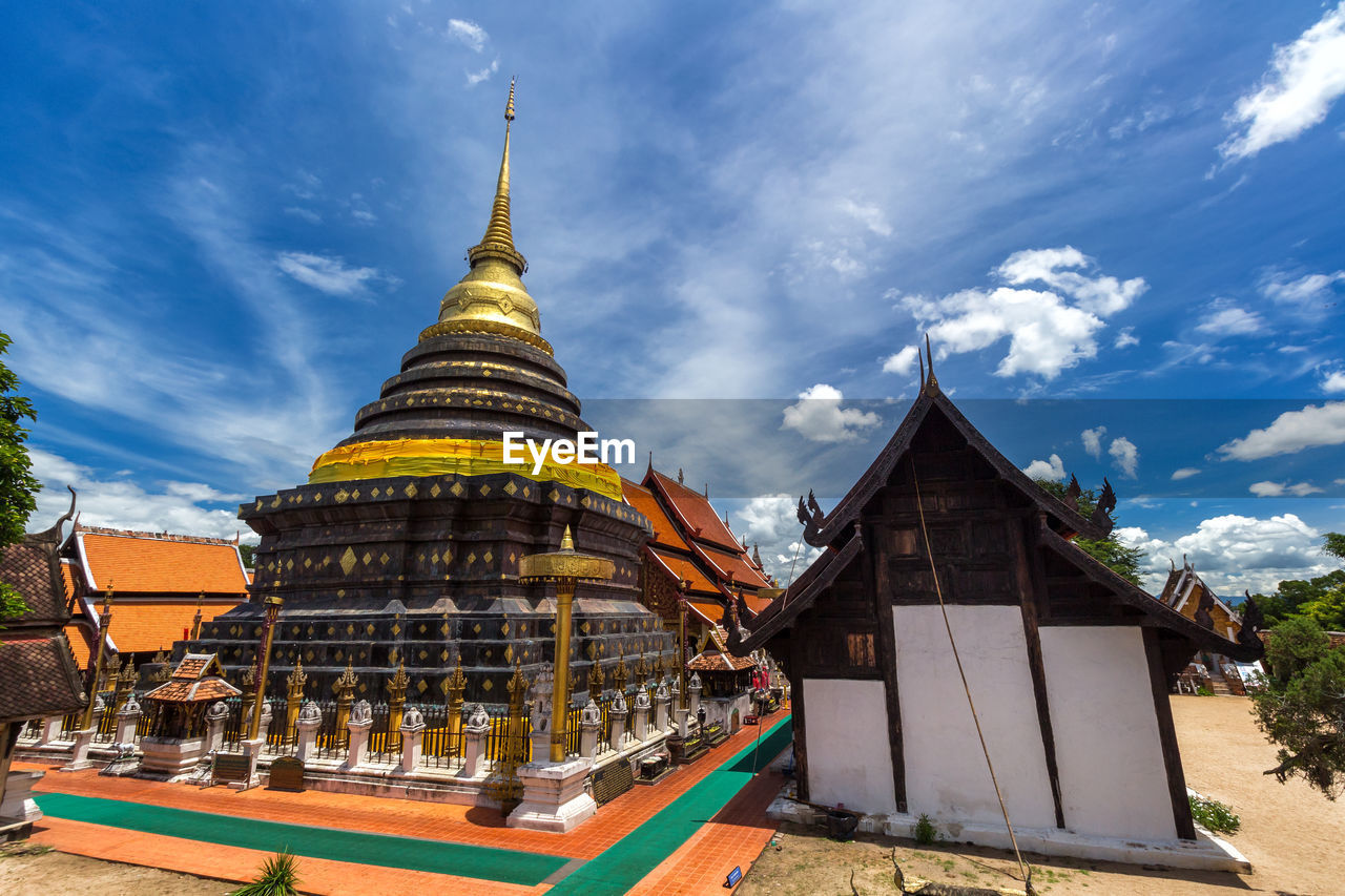 built structure, architecture, building exterior, religion, belief, place of worship, cloud - sky, building, sky, spirituality, travel destinations, nature, pagoda, day, no people, spire, outdoors, tower