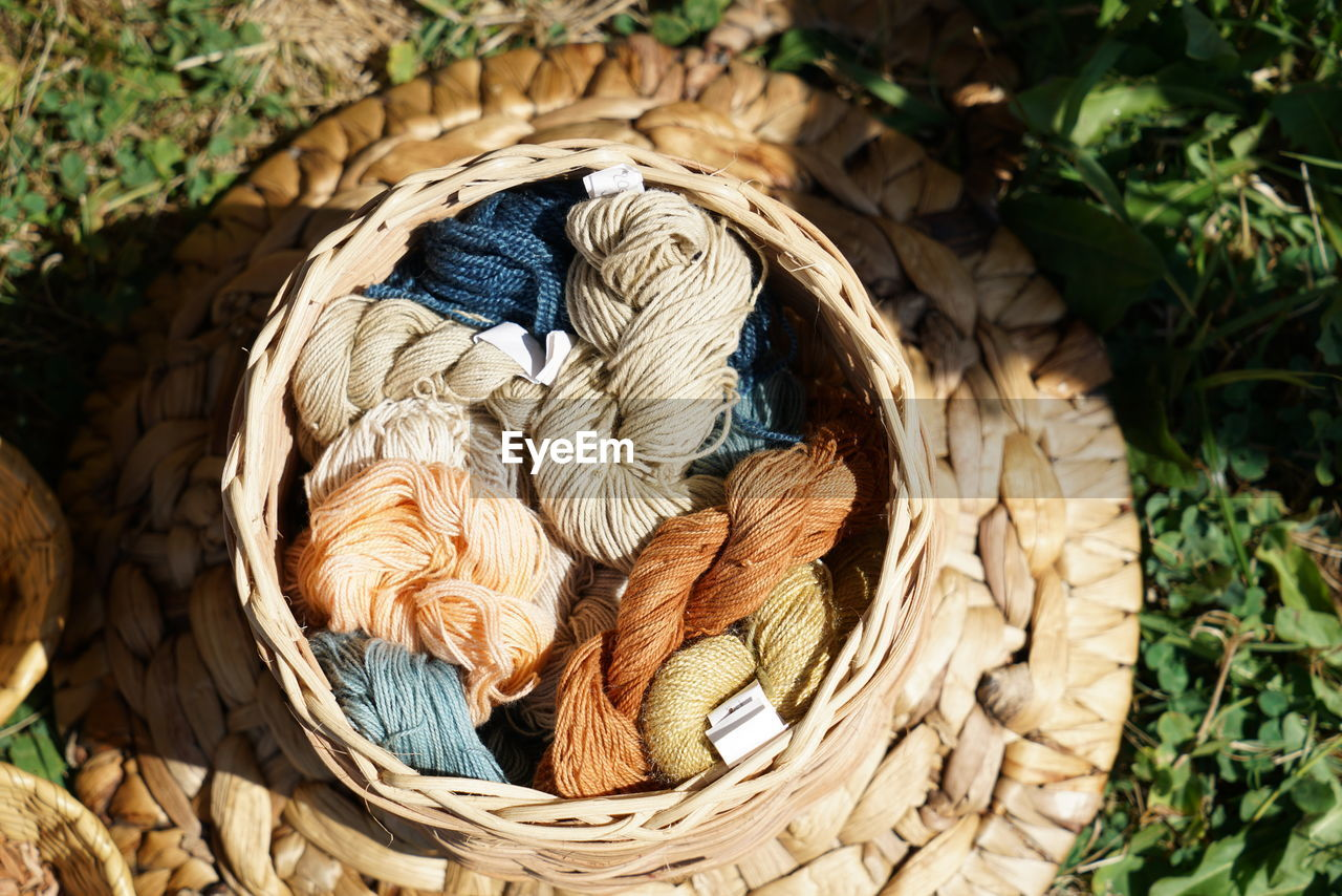 wicker, art and craft, basket, no people, craft, container, close-up, day, creativity, high angle view, still life, nature, pattern, outdoors, textile, wool, leaf, plant part, focus on foreground, brown, softness, intertwined