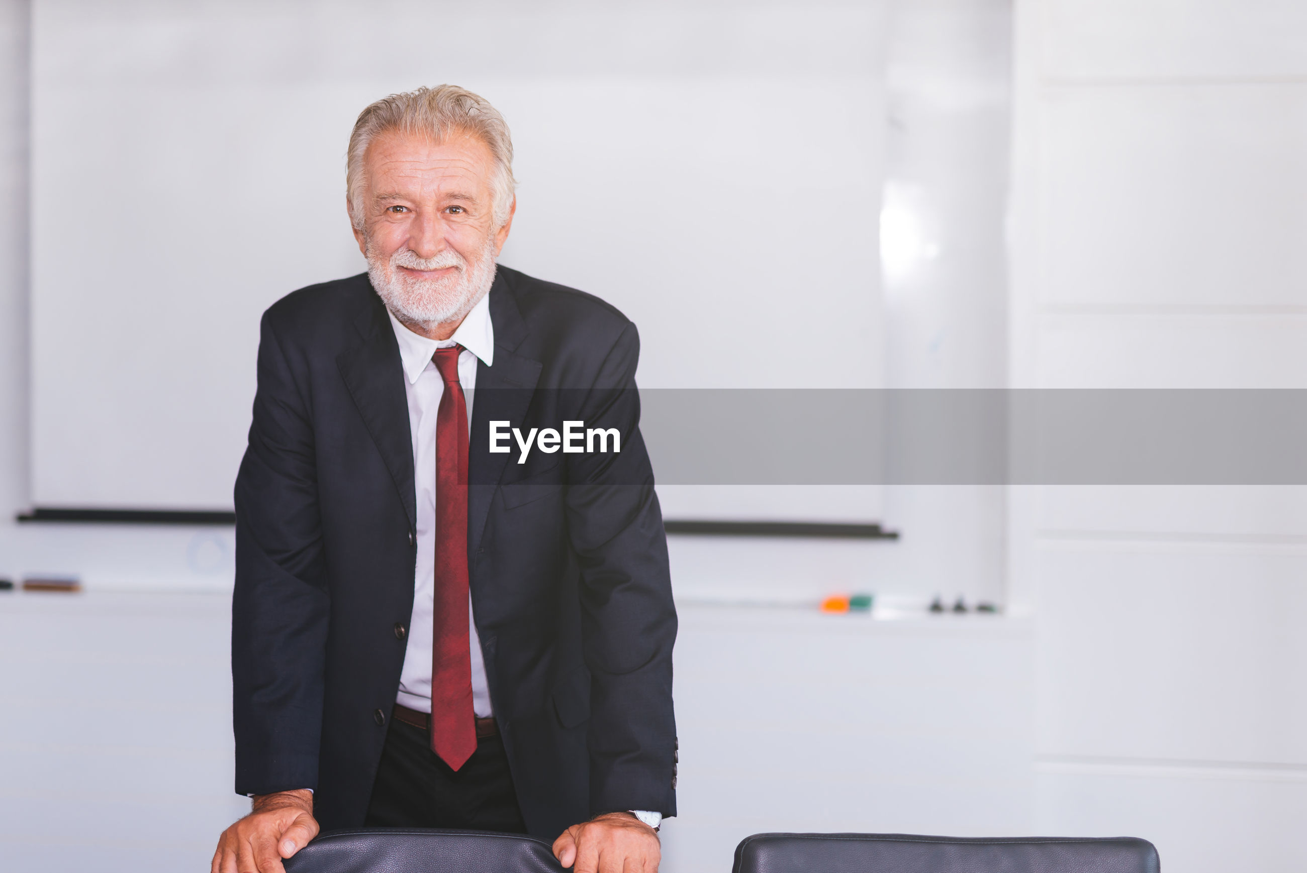 Portrait of smiling businessman standing at office