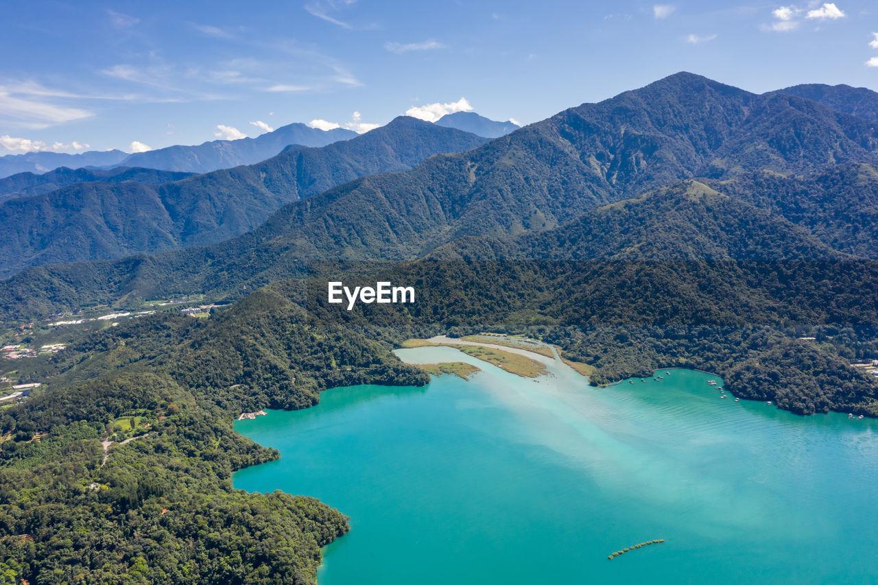 Aerial view of lake against mountain range