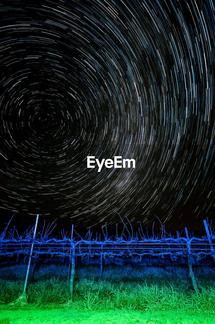 night, star - space, astronomy, space, star trail, long exposure, motion, sky, no people, nature, scenics - nature, illuminated, constellation, spinning, field, blurred motion, star field, land, circle, star, concentric