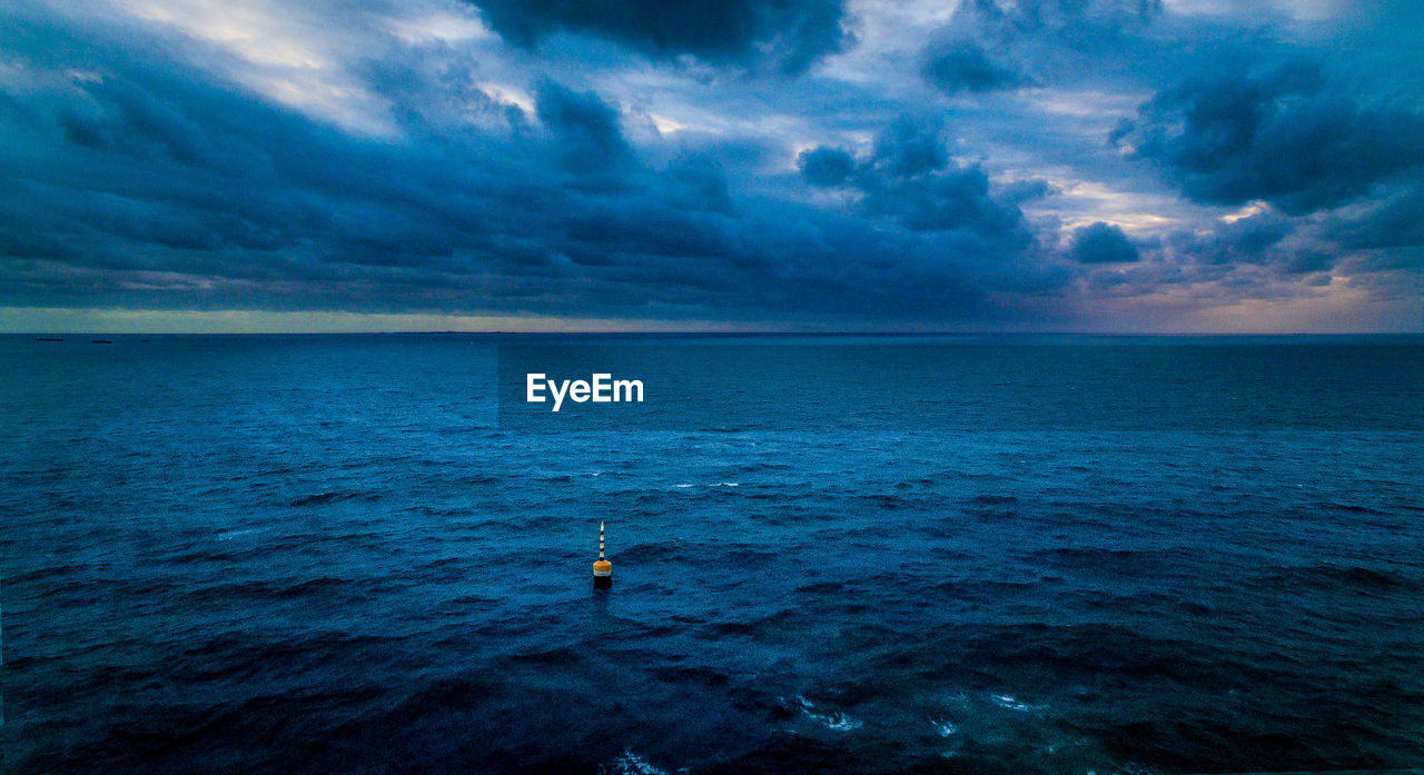 sea, horizon over water, water, cloud - sky, nature, sky, scenics, beauty in nature, tranquil scene, tranquility, one person, outdoors, rippled, nautical vessel, waterfront, adventure, sunset, day, storm cloud, one man only, sailing, people