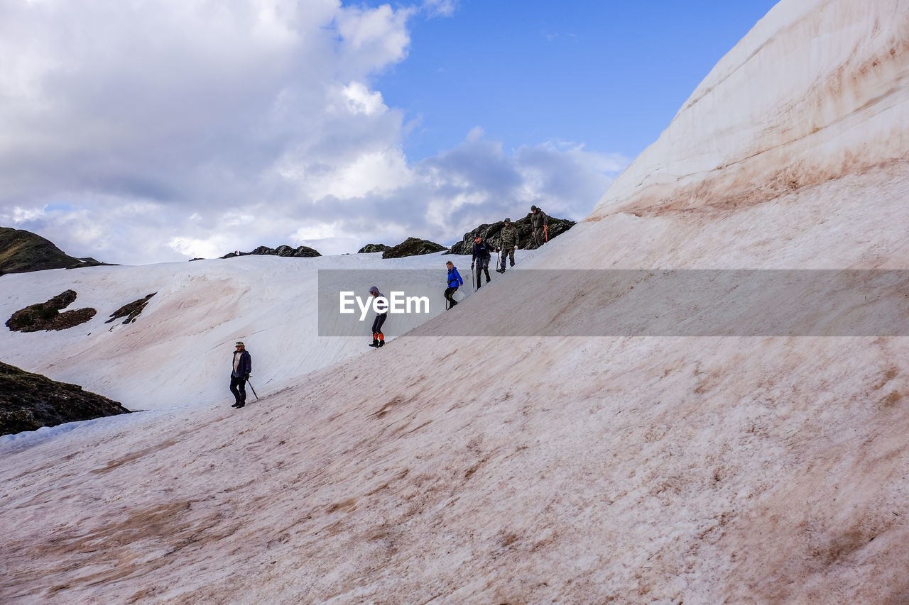 real people, leisure activity, sky, mountain, adventure, group of people, lifestyles, scenics - nature, cloud - sky, day, men, beauty in nature, activity, sport, people, holiday, travel, environment, vacations, hiking, outdoors