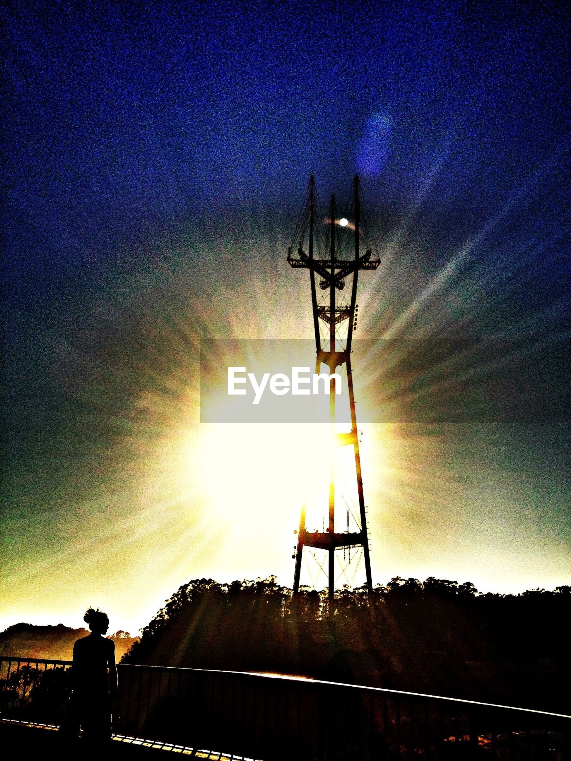 silhouette, sky, cloud - sky, technology, sunset, low angle view, connection, sun, dusk, night, dramatic sky, nature, electricity, weather, fuel and power generation, built structure, electricity pylon, crane - construction machinery, outdoors