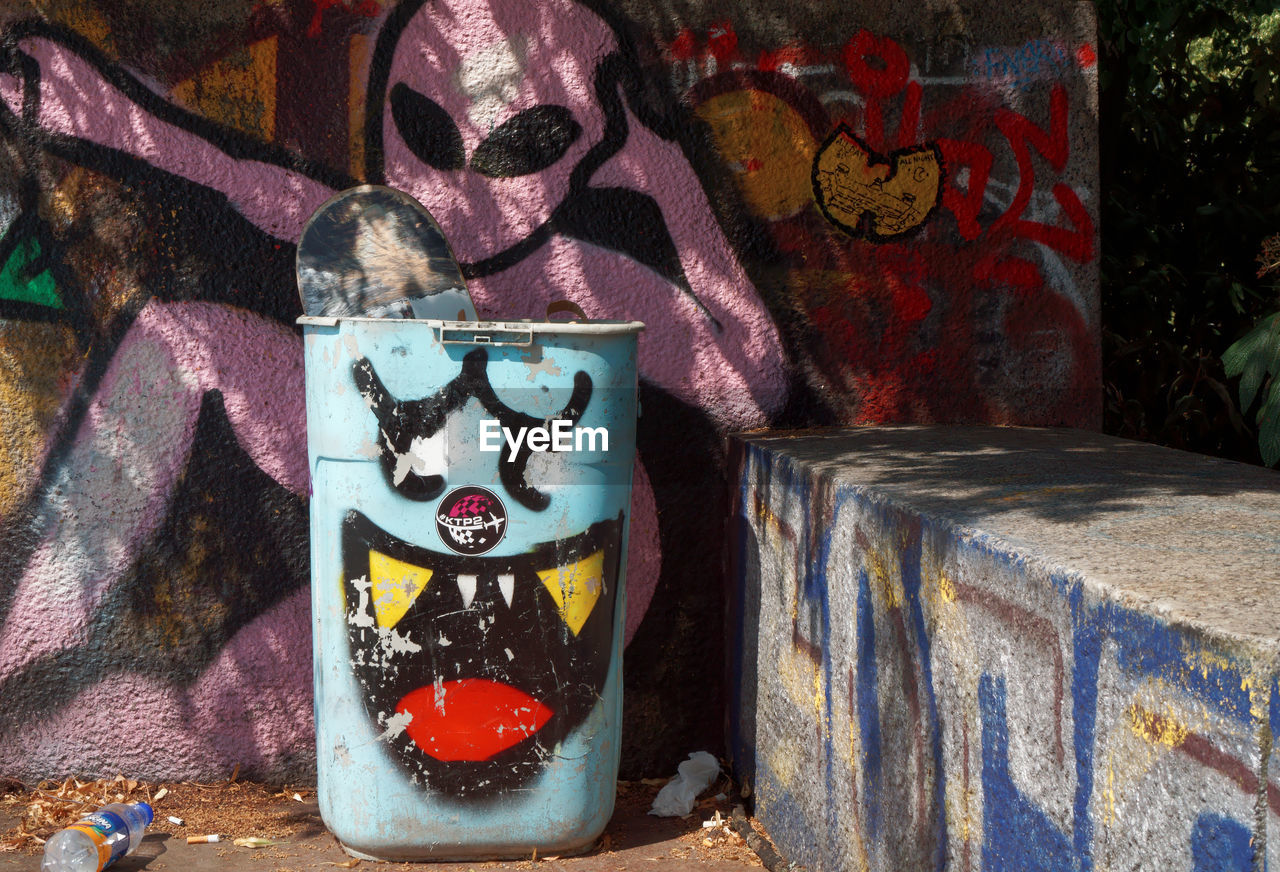 art and craft, representation, creativity, no people, human representation, graffiti, wall - building feature, craft, indoors, wall, day, mural, mammal, close-up, container, glass - material