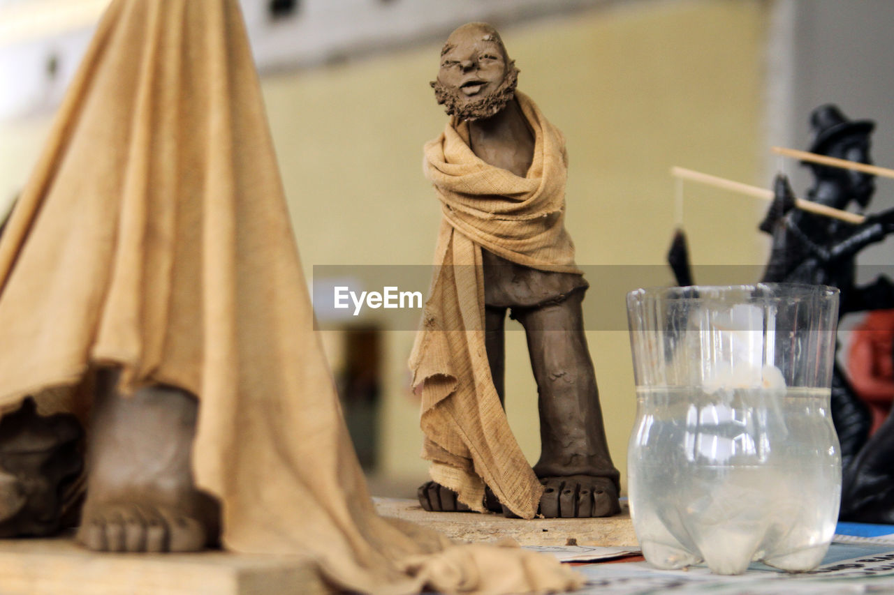 human representation, table, no people, statue, indoors, close-up, day