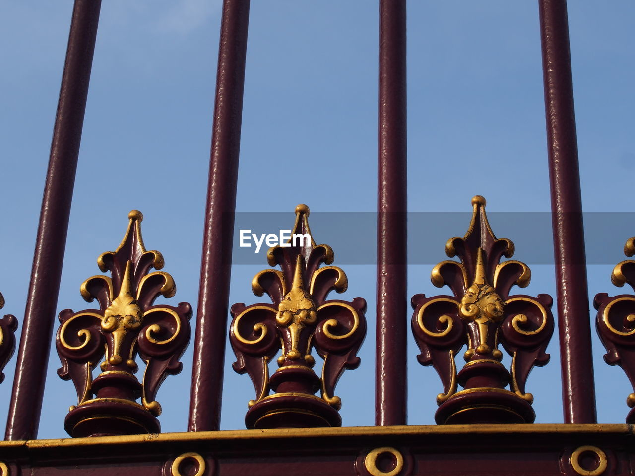 gate, clear sky, metal, low angle view, gold colored, day, outdoors, history, architecture, sky, gold, built structure, no people, wrought iron, building exterior, close-up