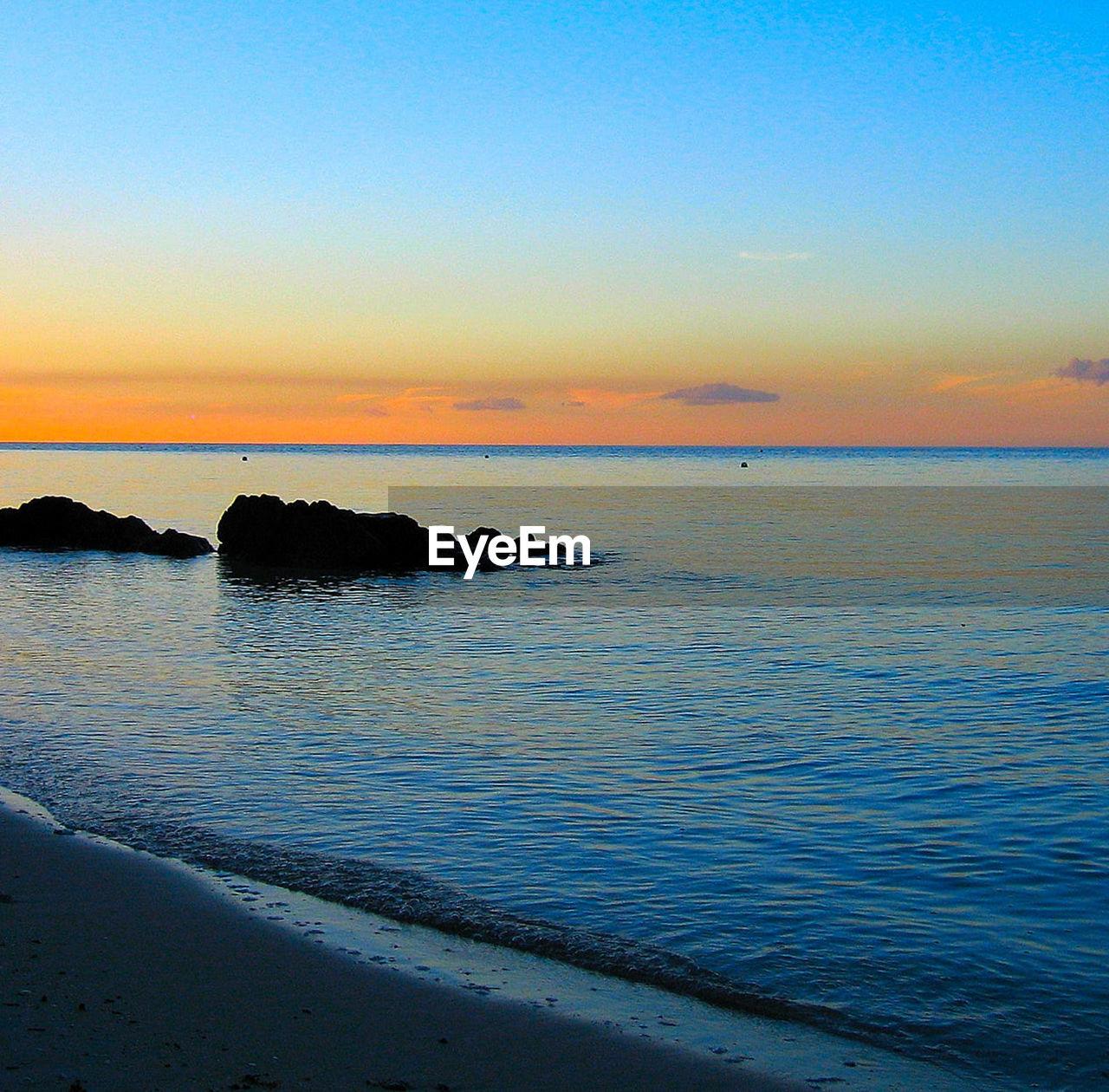 water, sea, sky, scenics - nature, beauty in nature, sunset, tranquil scene, tranquility, horizon over water, horizon, beach, land, idyllic, no people, orange color, nature, cloud - sky, non-urban scene, outdoors