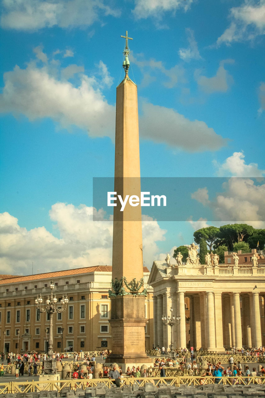Low Angle View Of Obelisk At St Peter Square Against Cloudy Sky