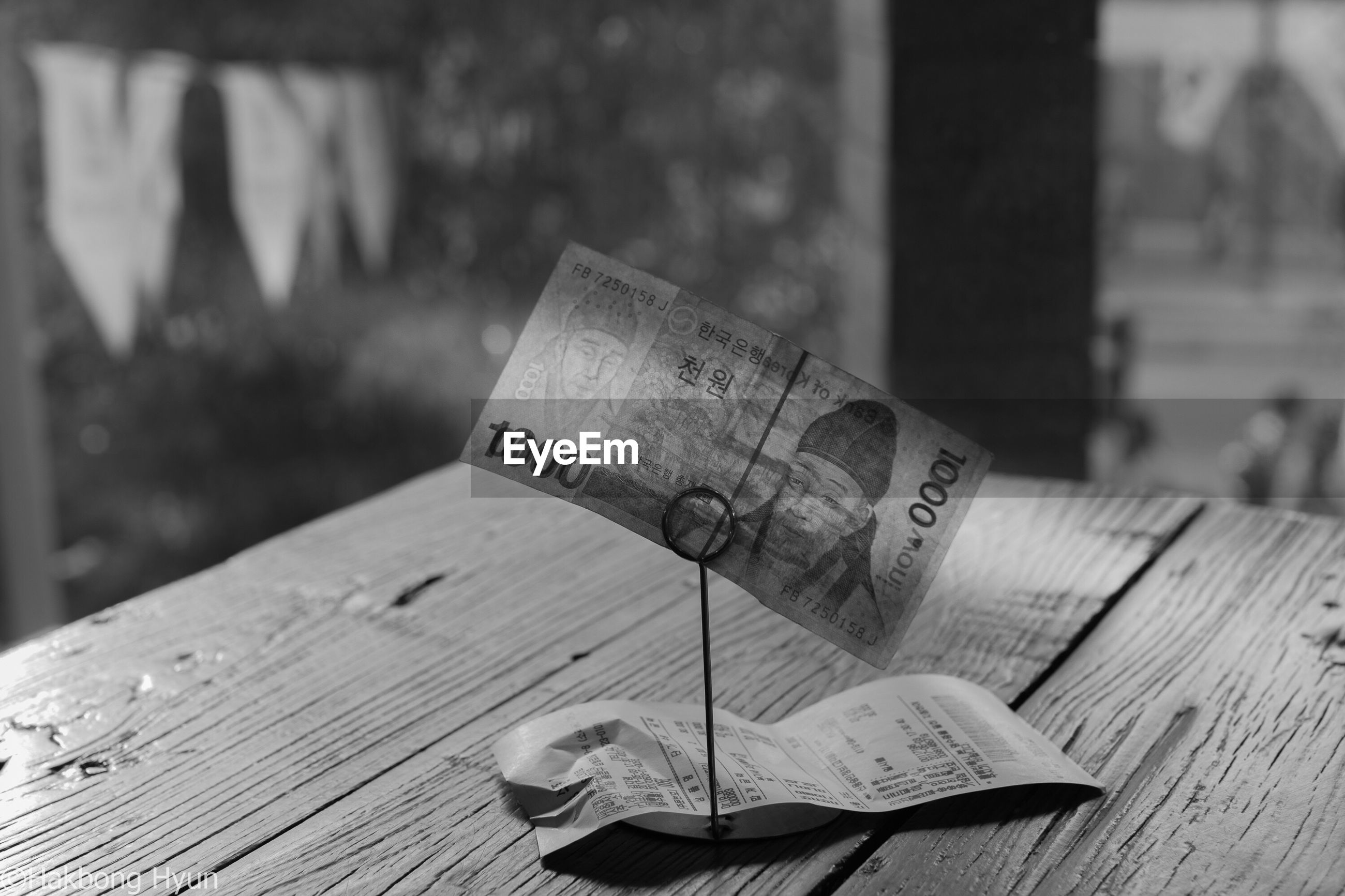 text, table, focus on foreground, communication, paper, book, close-up, wood - material, no people, indoors, day