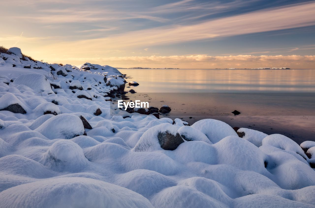 SCENIC VIEW OF SEA DURING WINTER AGAINST SKY