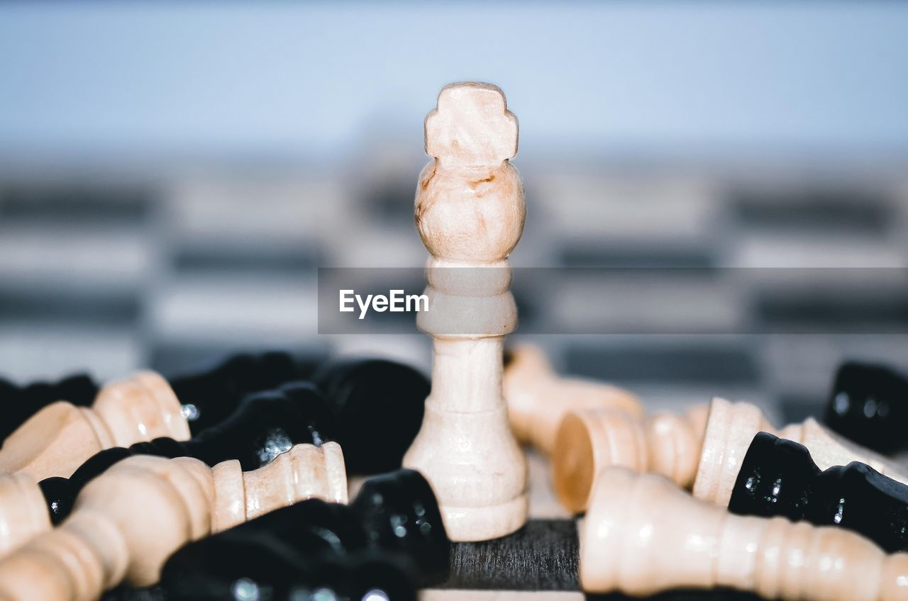 leisure games, sea, chess, board game, leisure activity, relaxation, game, close-up, water, chess piece, selective focus, strategy, focus on foreground, no people, horizon, day, horizon over water, nature, arts culture and entertainment, king - chess piece