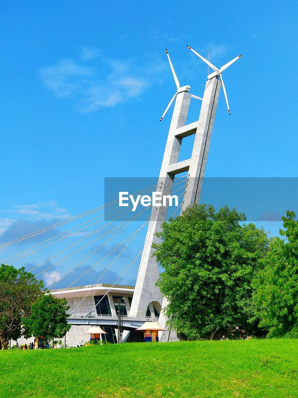 alternative energy, environmental conservation, wind power, wind turbine, renewable energy, fuel and power generation, windmill, field, grass, day, traditional windmill, sky, industrial windmill, outdoors, tree, no people, architecture, built structure, blue, growth, nature