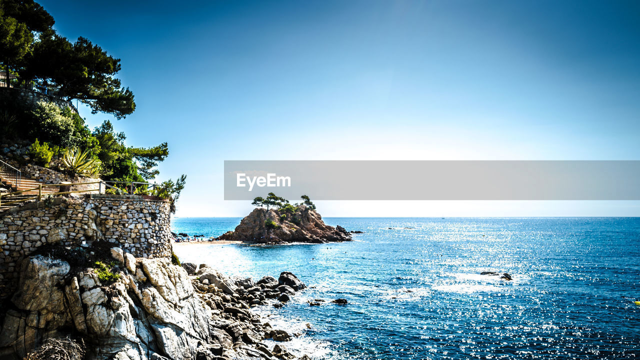 sea, water, sky, beauty in nature, horizon, horizon over water, scenics - nature, tree, nature, tranquility, blue, tranquil scene, land, day, beach, no people, clear sky, plant, rock, outdoors