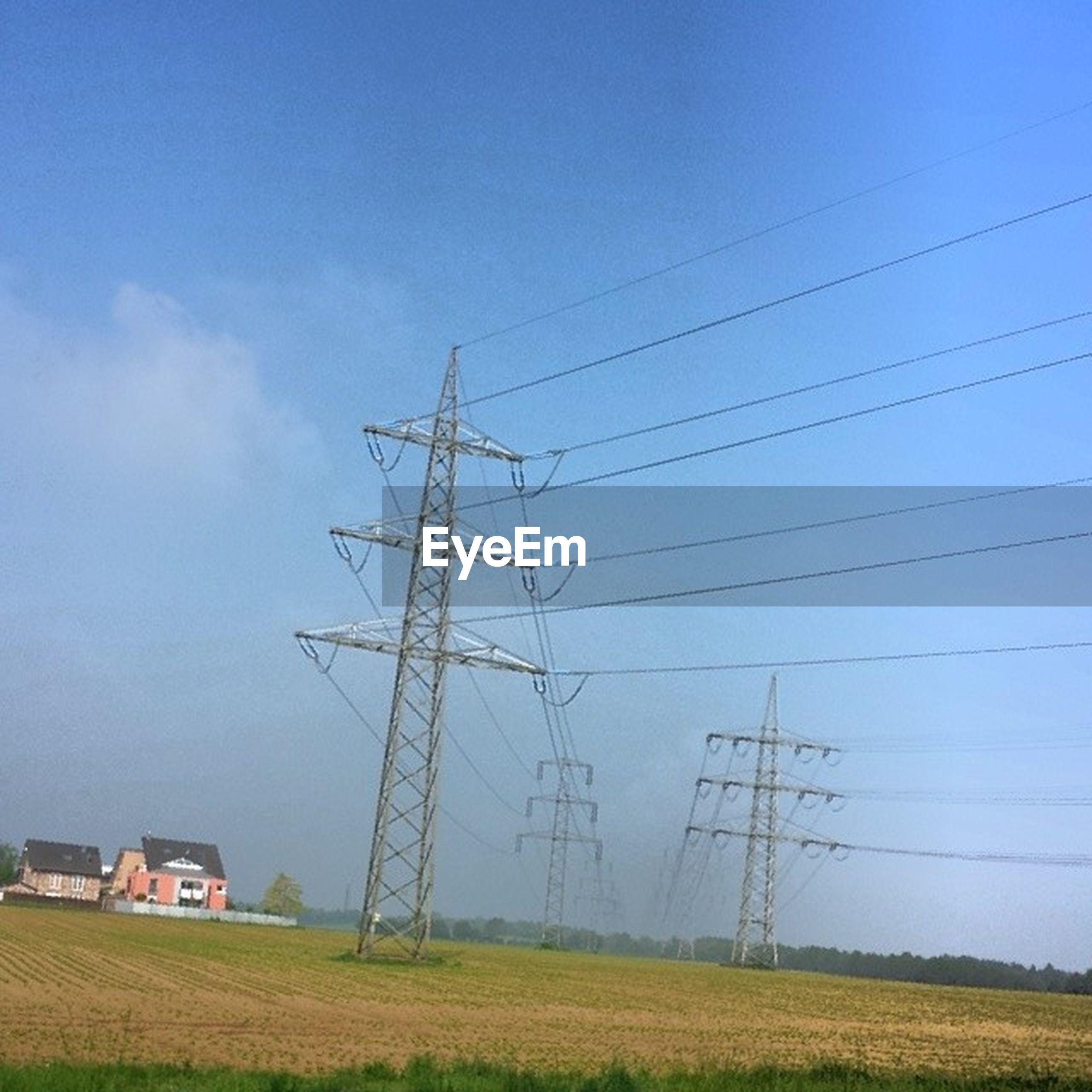 electricity pylon, power line, electricity, power supply, fuel and power generation, field, technology, cable, connection, sky, landscape, rural scene, grass, blue, clear sky, nature, agriculture, building exterior, power cable, no people