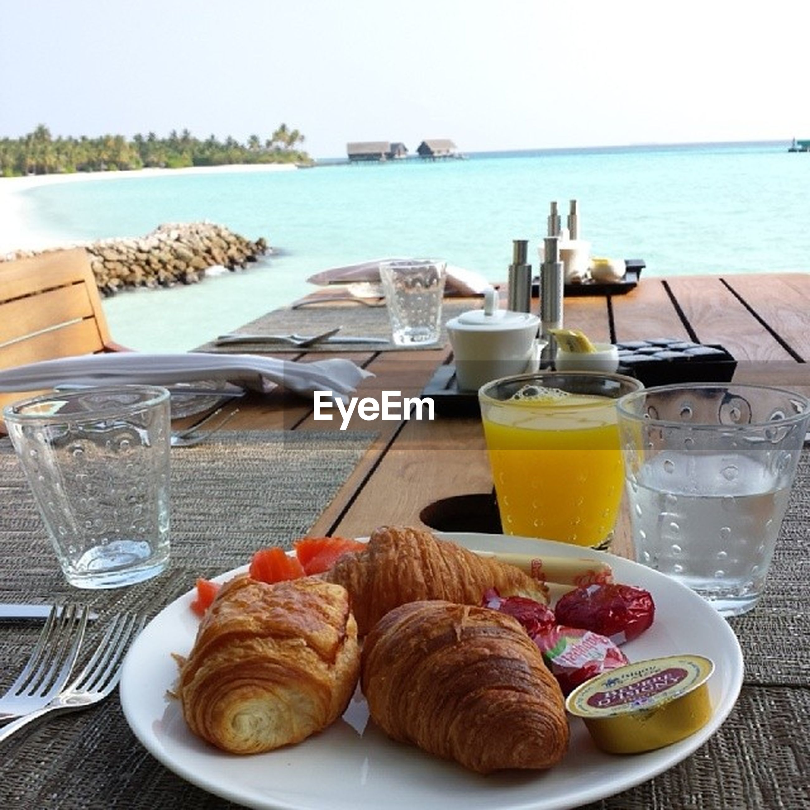 food and drink, table, drink, freshness, food, refreshment, plate, ready-to-eat, drinking glass, still life, sea, healthy eating, breakfast, serving size, water, indulgence, horizon over water, restaurant, indoors, coffee - drink