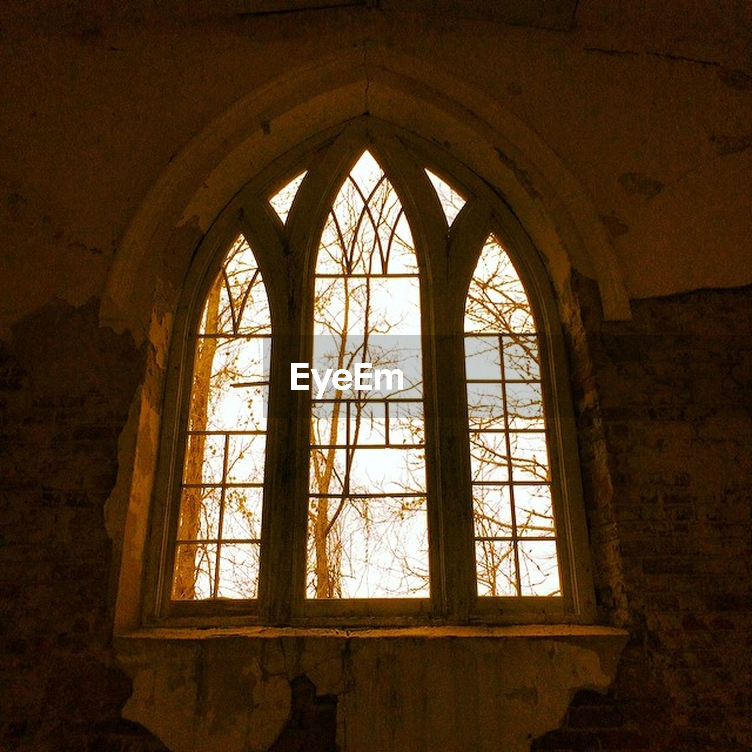 indoors, architecture, window, arch, built structure, interior, no people, ceiling, archway, building, low angle view, wall - building feature, history, stained glass, day, church, pattern, dark, home interior, sunlight