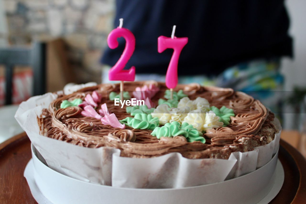Close-Up Of Number 27 Candles On Birthday Cake