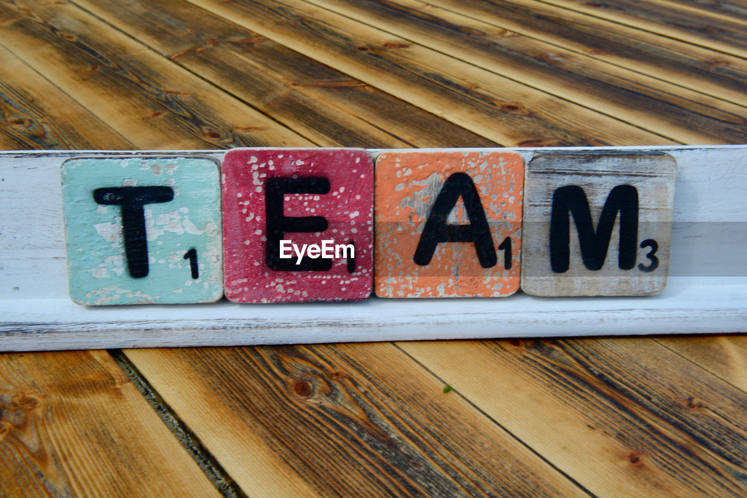 High angle view of text blocks on wooden table