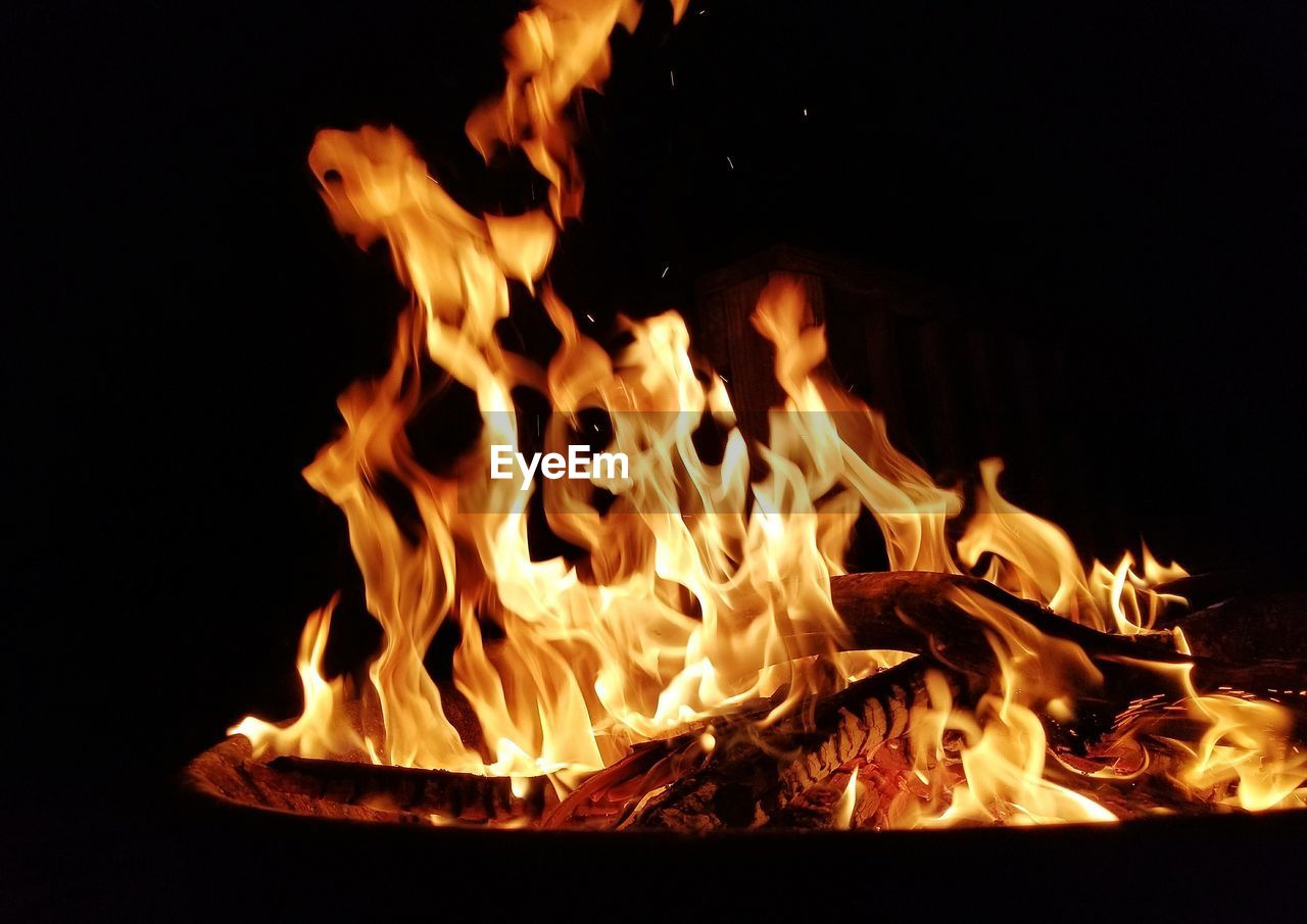 flame, burning, heat - temperature, night, orange color, glowing, no people, close-up, bonfire, outdoors, wood - material, fire pit