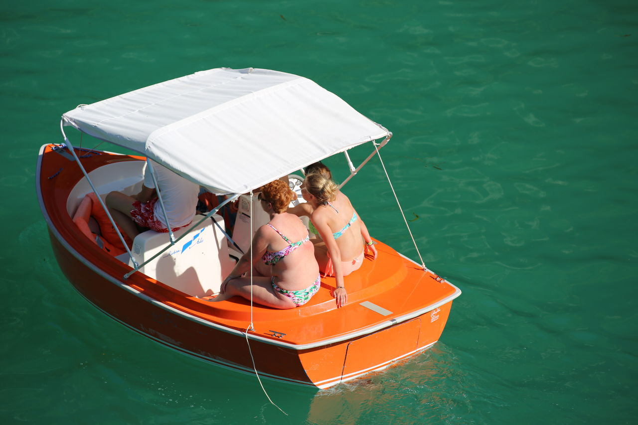 People sailing on boat in sea