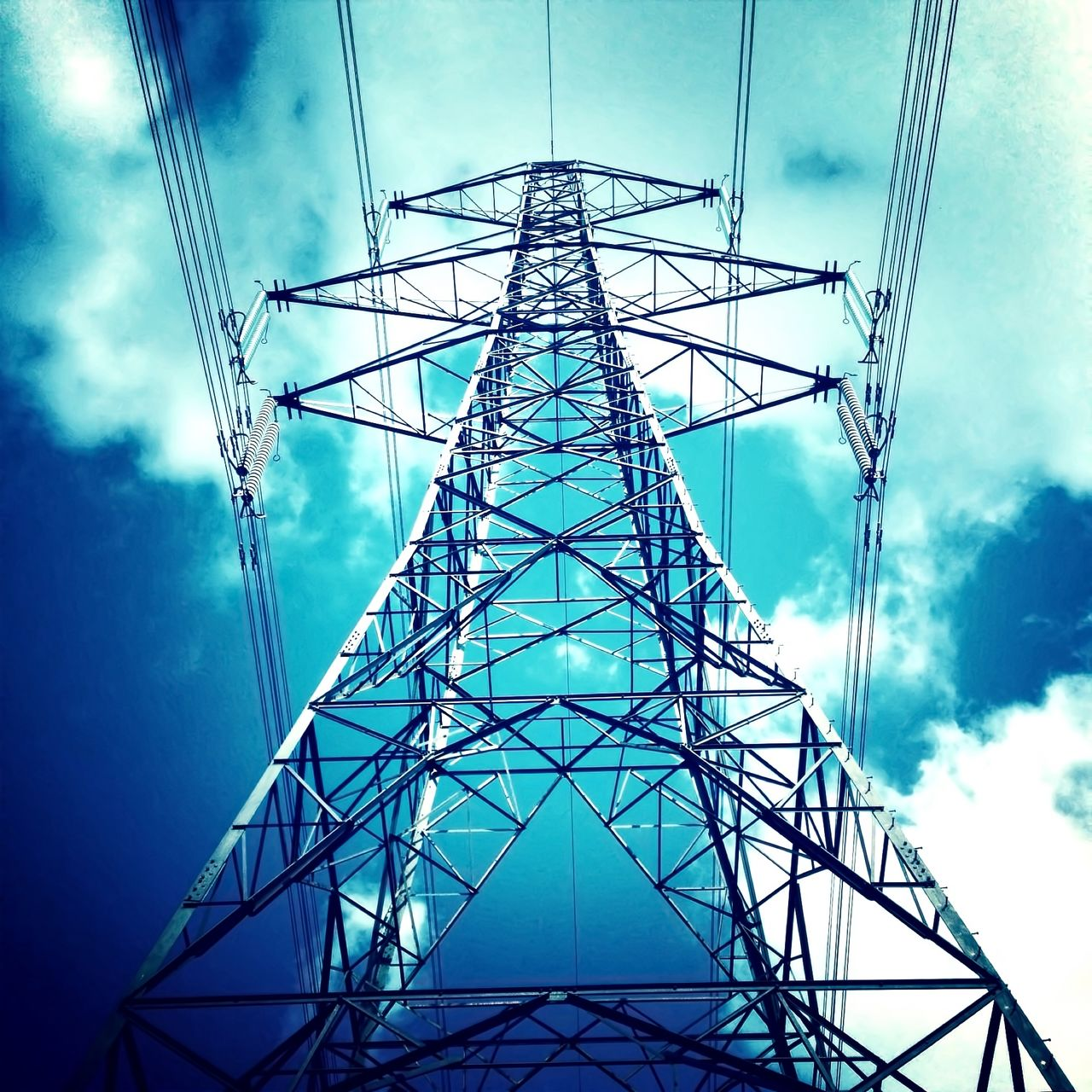 electricity pylon, cable, cloud - sky, sky, electricity, power supply, fuel and power generation, connection, low angle view, no people, technology, day, global communications, symmetry, girder, outdoors