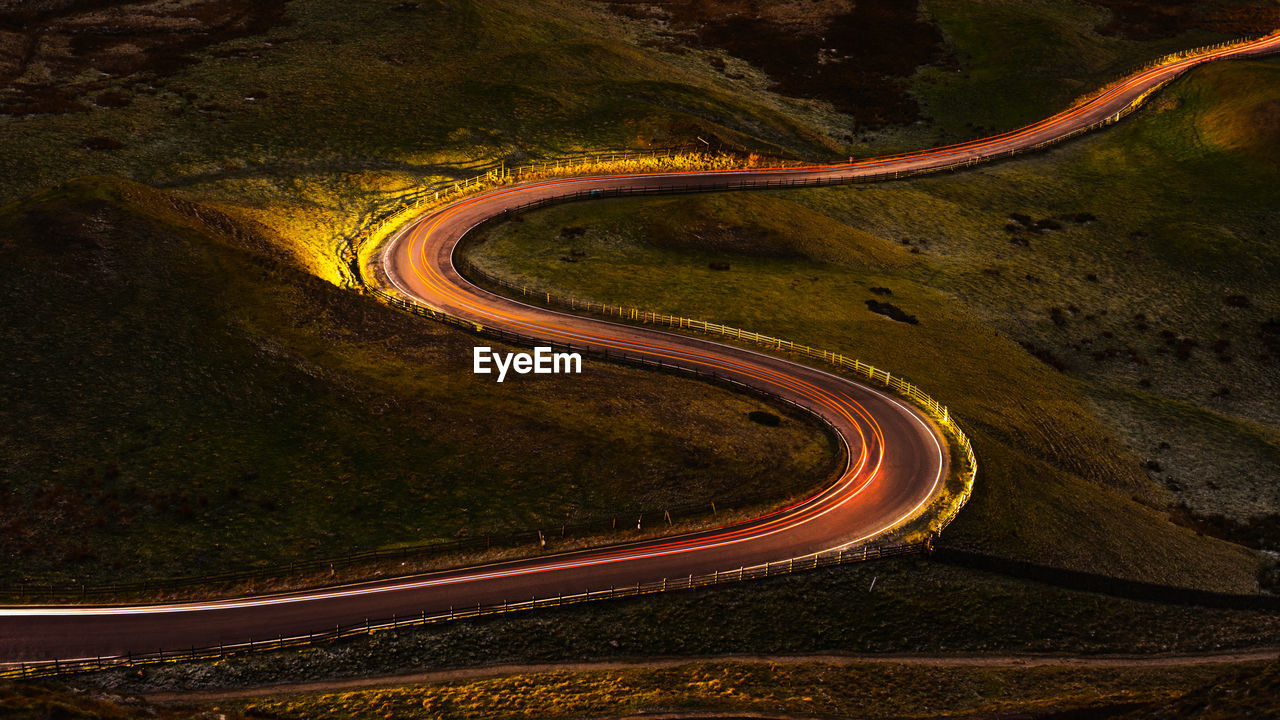 road, transportation, curve, no people, high angle view, nature, winding road, mode of transportation, environment, illuminated, mountain, non-urban scene, beauty in nature, tranquility, long exposure, night, scenics - nature, light trail, street, mountain road, outdoors