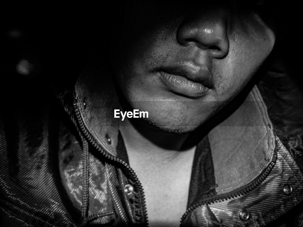 Close-up of man face in darkroom