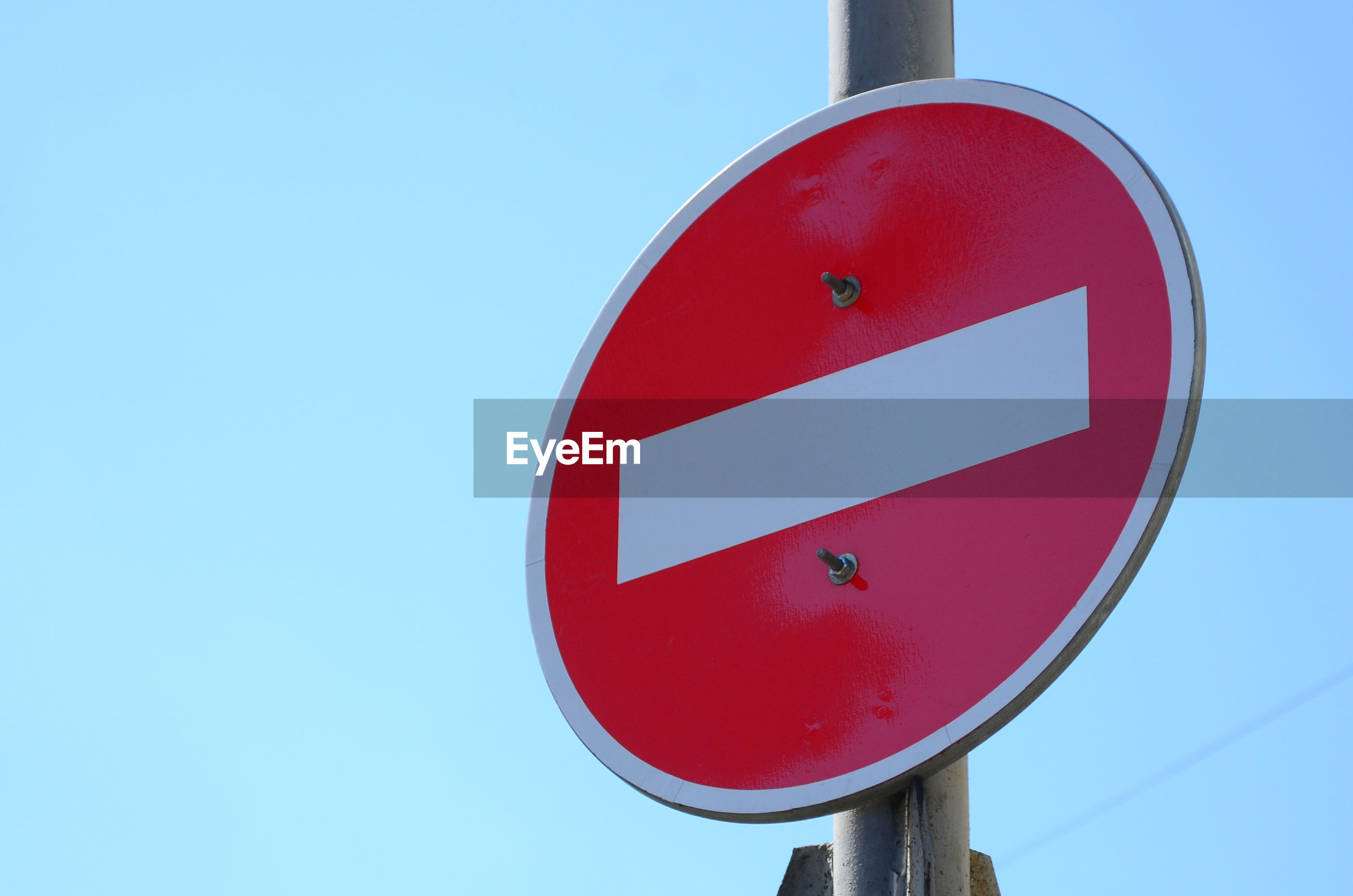 Low angle view do not enter sign against sky
