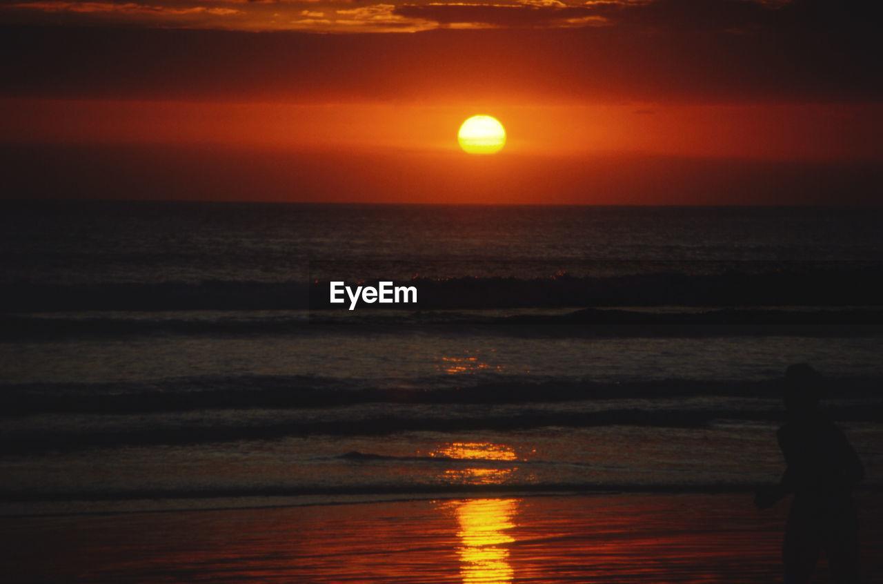 sunset, sky, water, sea, orange color, scenics - nature, beauty in nature, horizon over water, horizon, tranquility, sun, tranquil scene, idyllic, silhouette, nature, beach, land, reflection, non-urban scene, outdoors