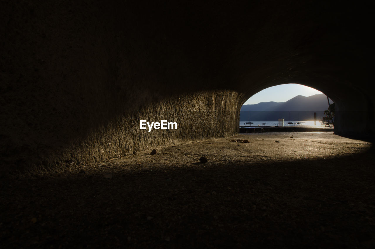 Lake Maggiore And Mountains Seen Through Tunnel