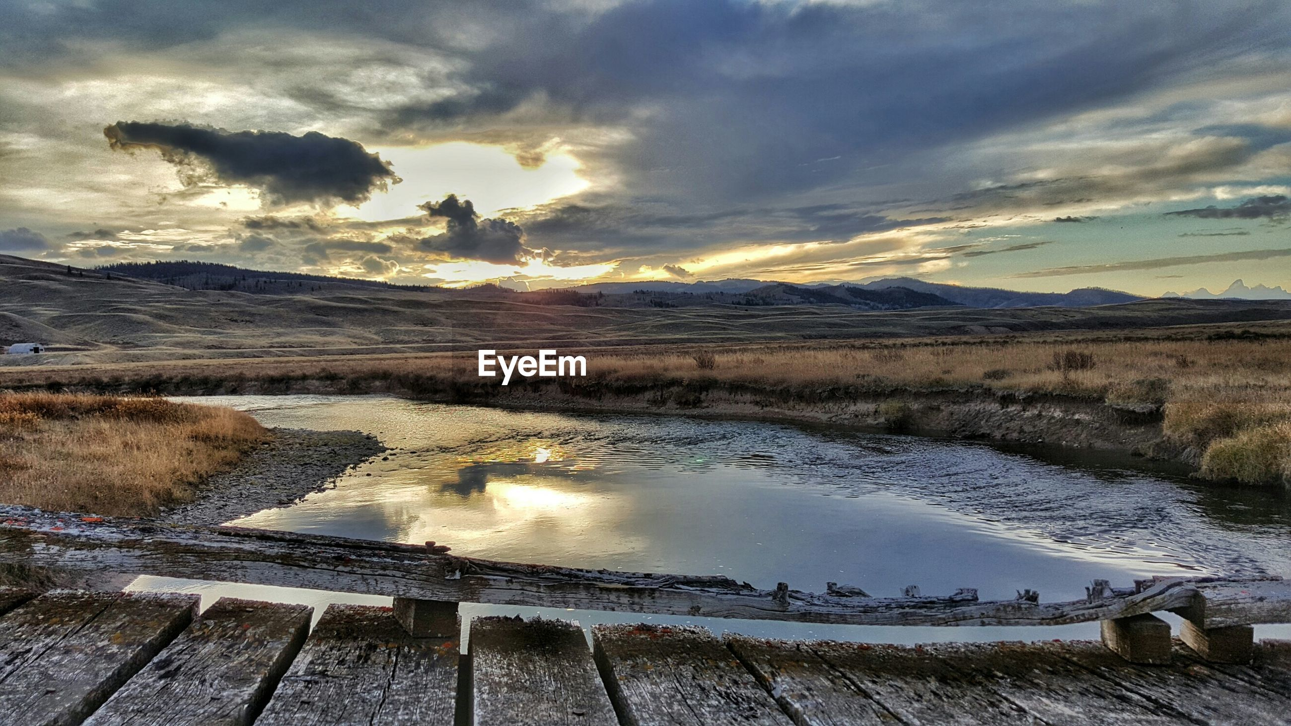 sky, cloud - sky, water, tranquil scene, cloudy, weather, tranquility, scenics, nature, landscape, beauty in nature, lake, cloud, sunset, high angle view, field, mountain, non-urban scene, winter, reflection