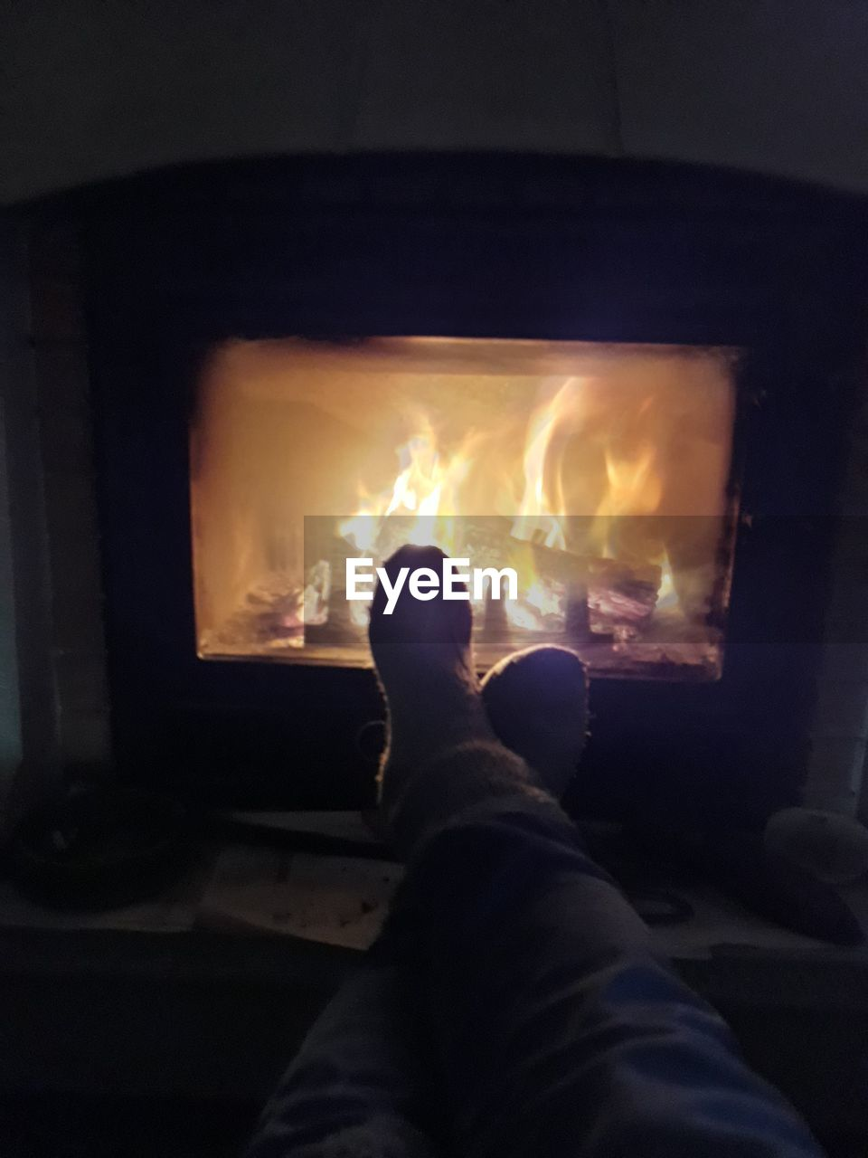 burning, heat - temperature, flame, indoors, fireplace, one person, real people, men, low section, illuminated, night, close-up, people