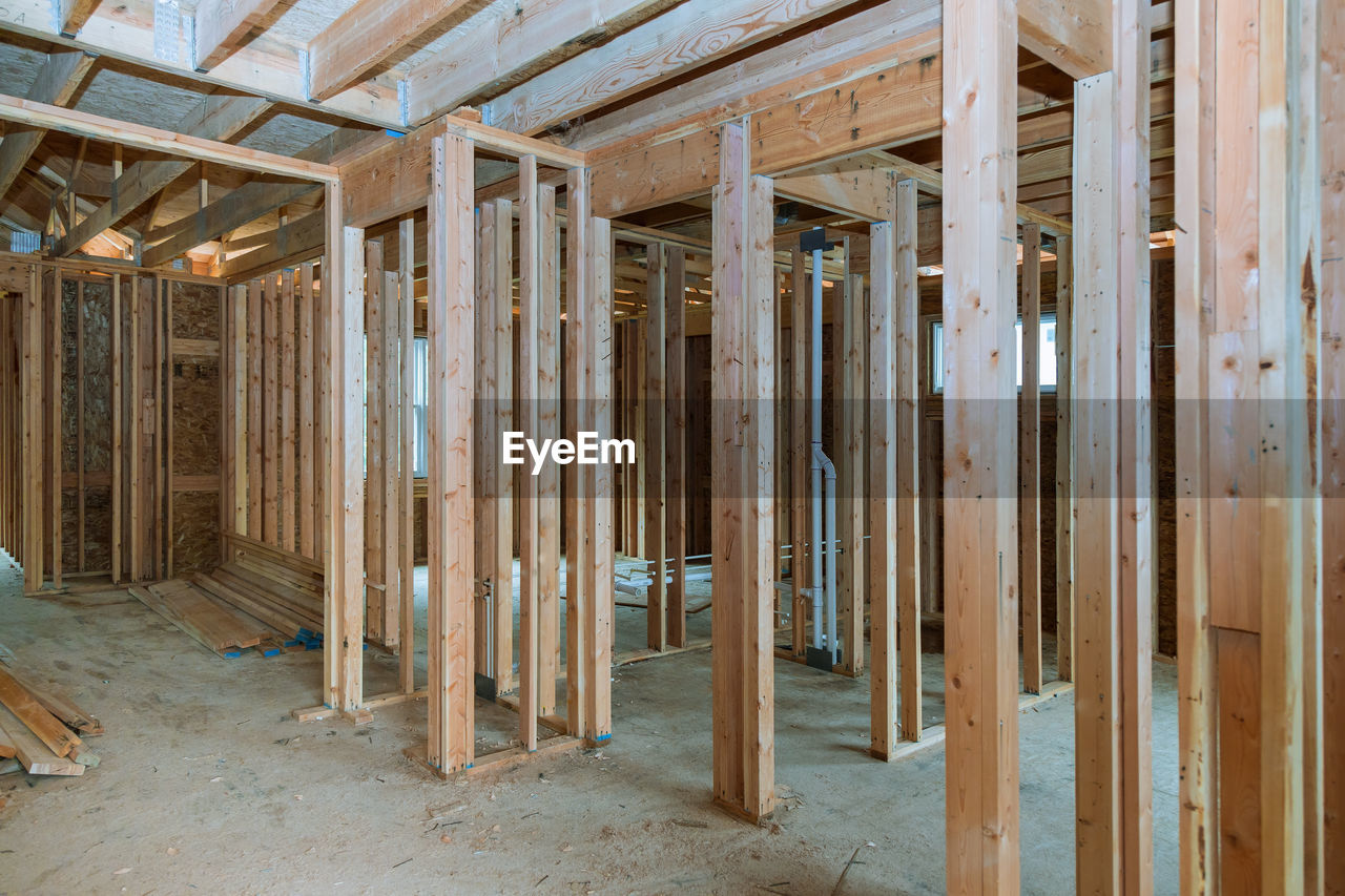architecture, wood - material, built structure, no people, construction industry, construction site, indoors, industry, construction frame, incomplete, development, day, brown, building, journey, pattern, home ownership, wood, in a row, roof beam, ceiling, home improvement