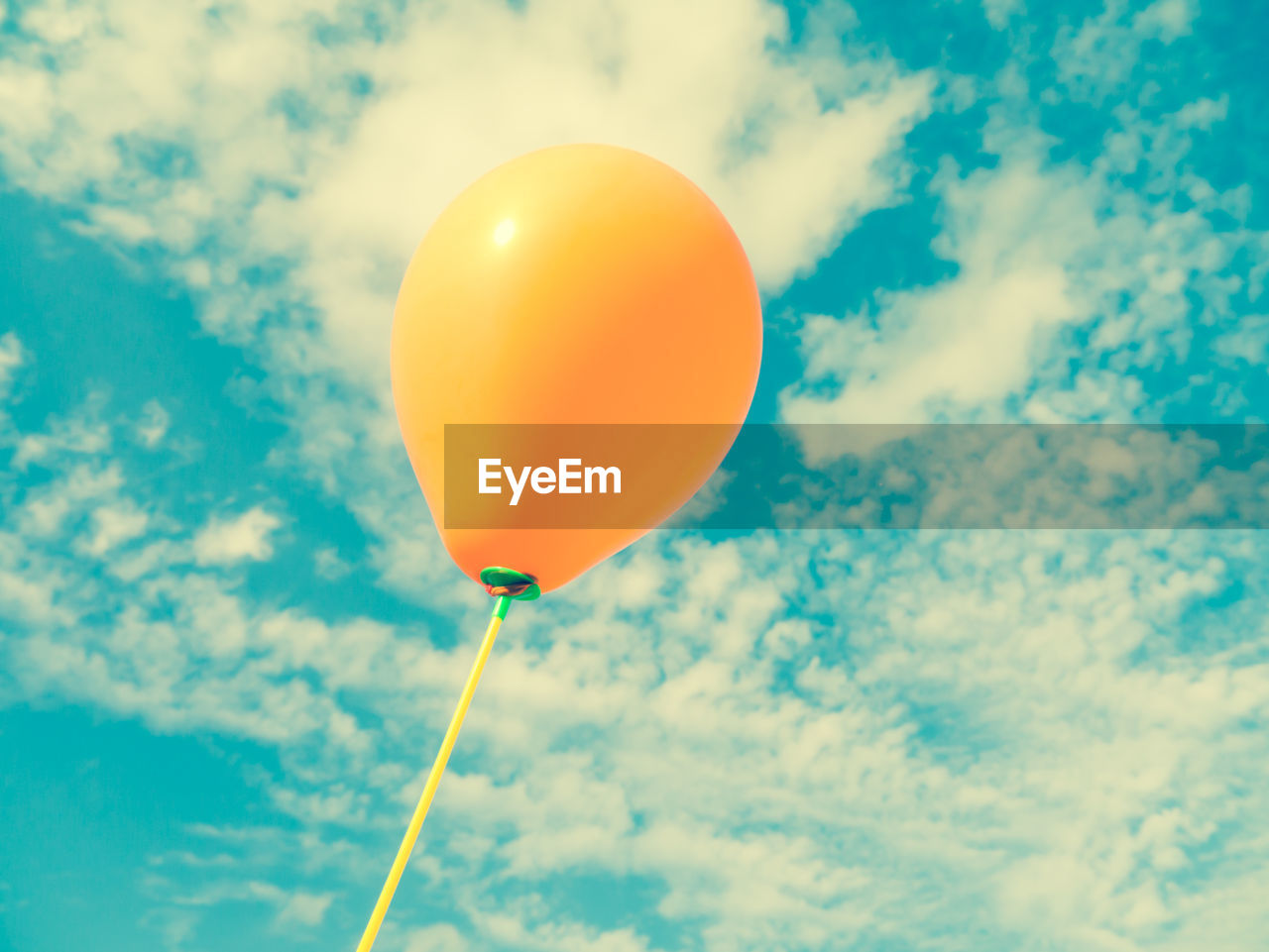 balloon, cloud - sky, sky, low angle view, nature, celebration, helium balloon, flying, day, no people, mid-air, string, white color, blue, outdoors, multi colored, vulnerability, yellow, fragility, orange color, helium