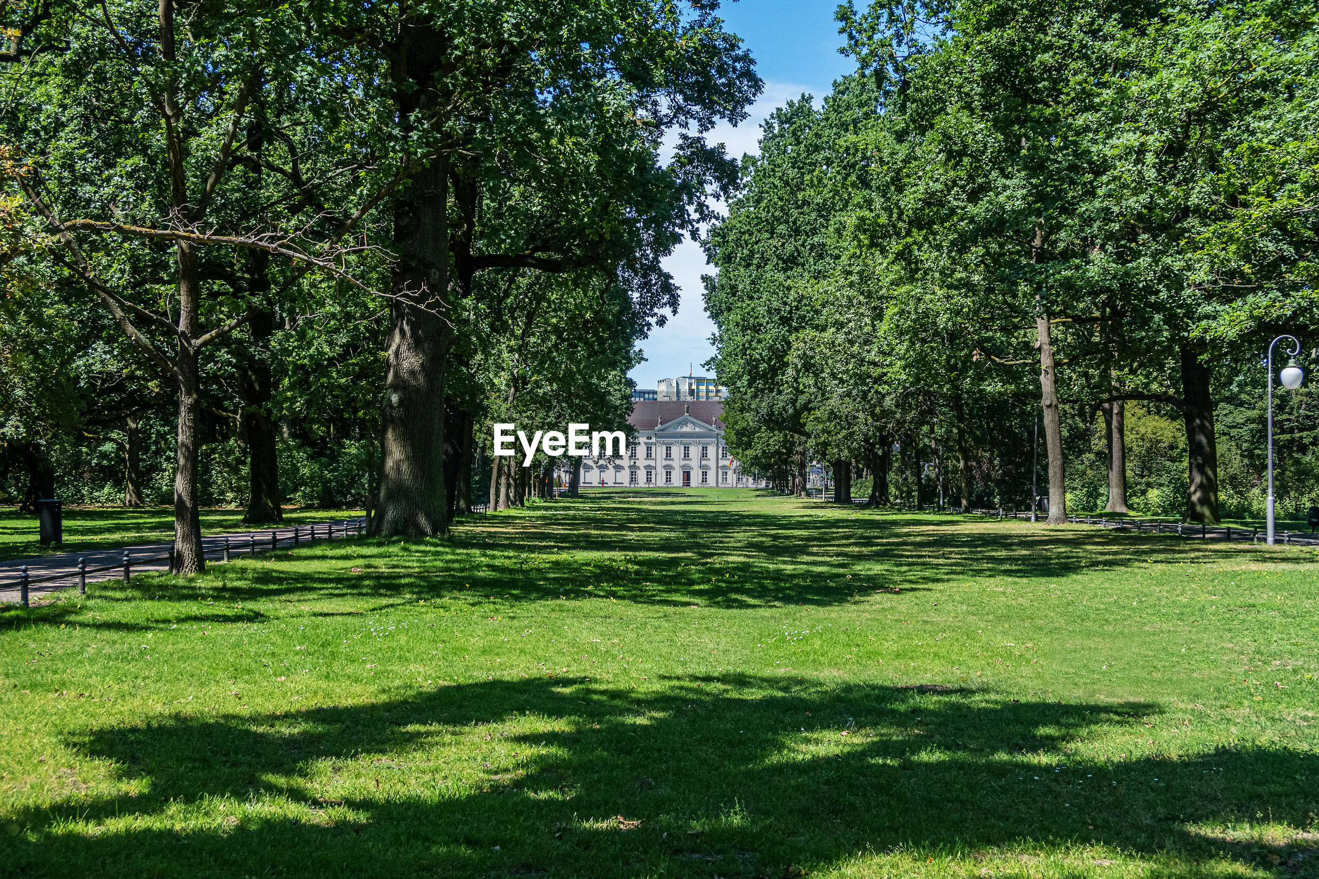 Tiergarten park in berlin, germany with bellevue palace in distance on sunny day