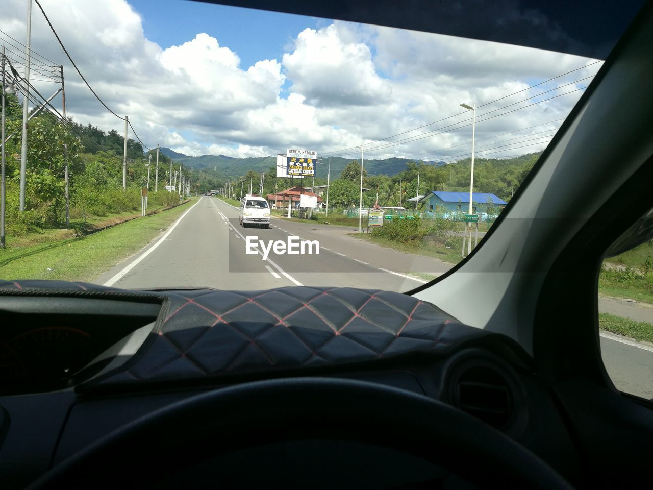 car, transportation, vehicle interior, car interior, glass - material, land vehicle, cloud - sky, windshield, sky, mode of transport, road, day, dashboard, travel, steering wheel, no people, car point of view, the way forward, tree, nature, close-up, outdoors