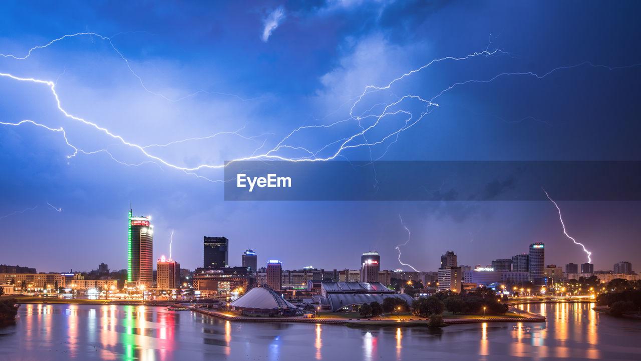 Lightning Over River Against Sky