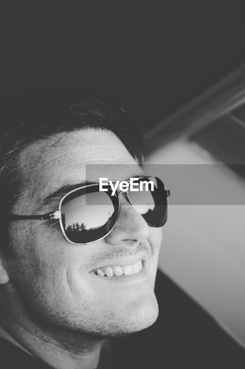 Close-up of happy mature man wearing sunglasses