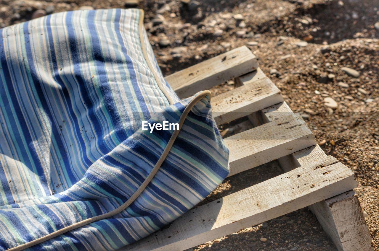High Angle View Of Fabric On Wood