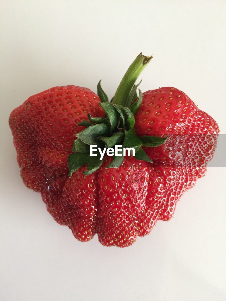 High angle view of strawberry against white background